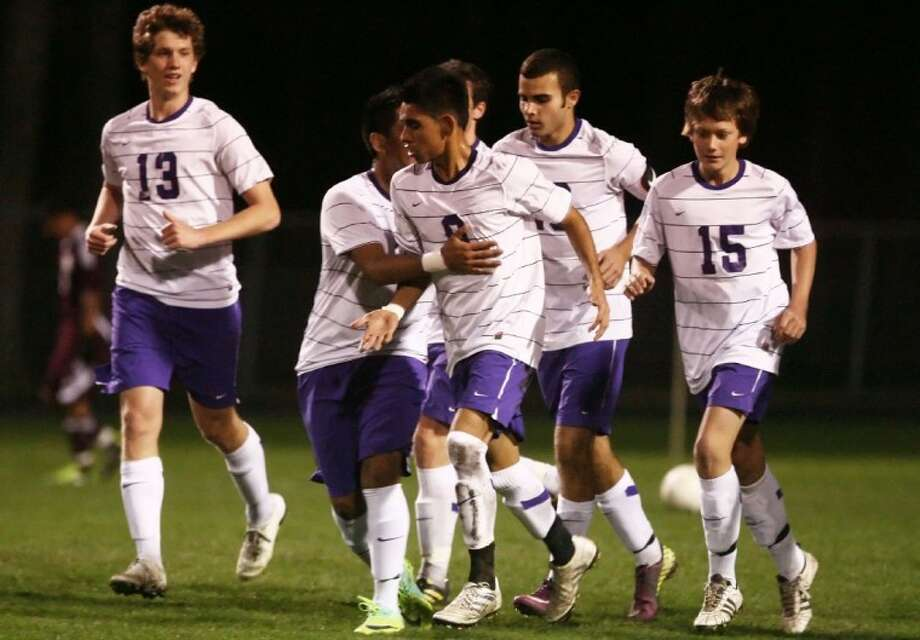 Montgomery players celebrate after scoring a goal against Magnolia on Tuesday at Montgomery High School. See more photos online at www.yourconroenews.com/photos. Photo: Staff Photo By Karl Anderson