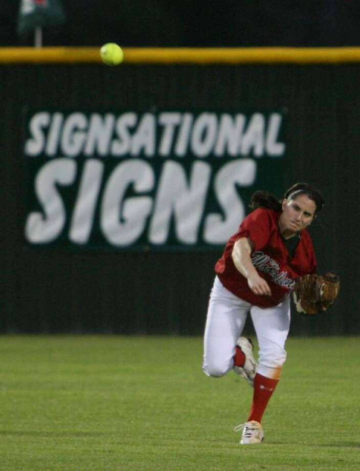The Woodlands' Kelsey Jolly throws the ball in during Tuesday's non-district game against Montgomery.