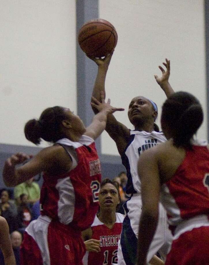 College Park's Alexia Sanders drives to the basket during Tuesday night's game.