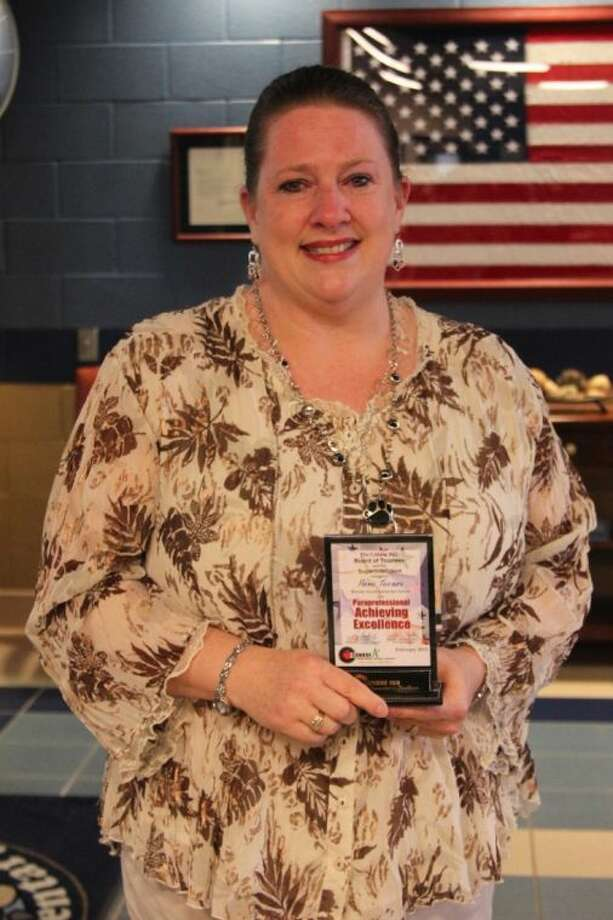 Pam Turner displays her Para- professional Ambassador Award.