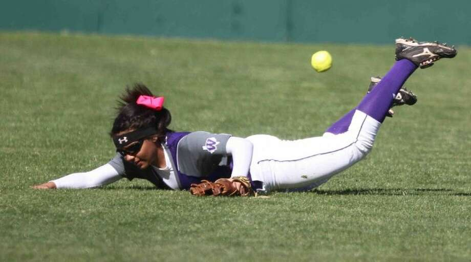 Willis outfielder Aliah Kizzy gives it her all on a Texas League single in the Ladykats' game with St. Pius at the Willis Ladykat Softball Tournament. St. Pius won 3-2. Photo: Jason Fochtman