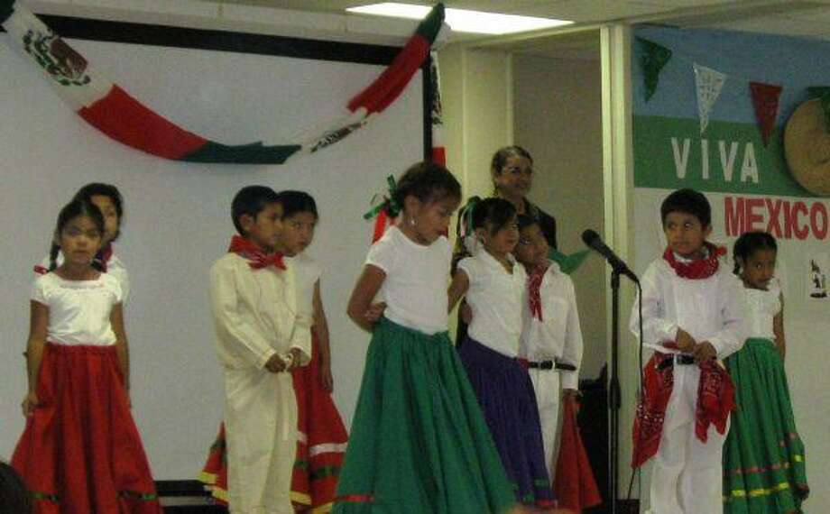 First-graders in Mrs. Rodriguez's class, from left, Monserrath Angeles, Miguel Avalos, Kevin Bonilla, Angela Lopez, Gloria Martinez, Dyana Resendez, Ivan Sanchez and Jonathon Limon participate in a Cinco de Mayo celebration at Greenleaf Elementary.