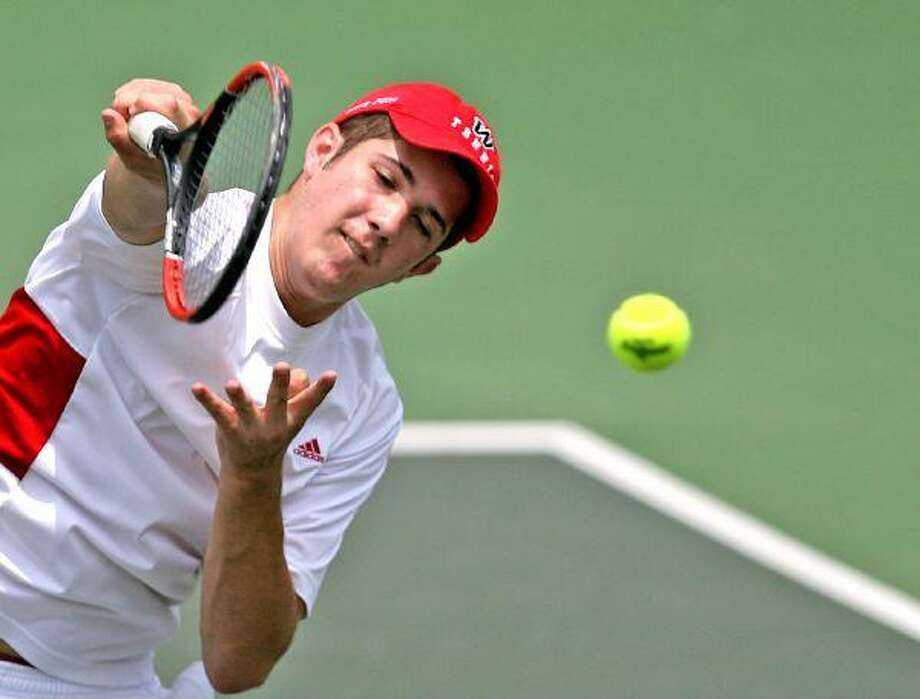 The Woodlands's Zach Martinez keeps his eye on the ball during mixed doubles play at the UIL State Tennis Tournament at the Penick-Allison Tennis Center in Austin Monday. / The Courier