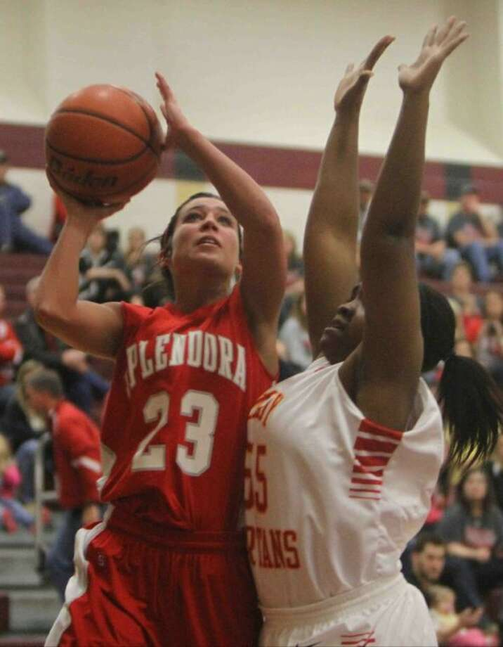 Splendora guard Lynze Brode goes up for a shot as Stafford post Kia Faniel defends during a Region III-3A area playoff game Friday at Summer Creek High School. To view or purchase this photo and others like it, visit HCNpics.com. Photo: Jason Fochtman