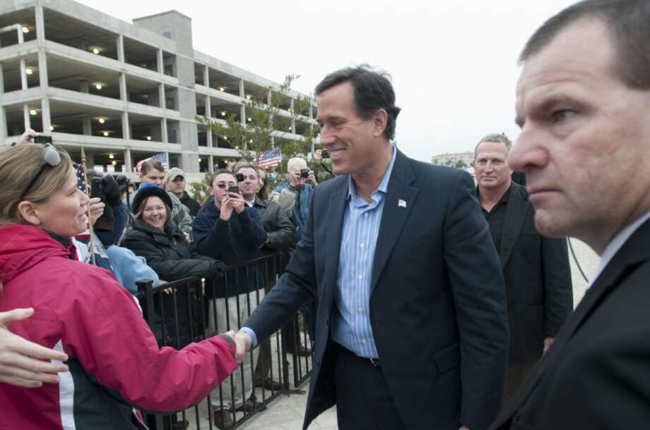 Republican presidential candidate, former Pennsylvania Sen. Rick Santorum greets supporters as he arrives to speak at the Bella Donna Chapel in McKinney Wednesday. Photo: Rex C. Curry