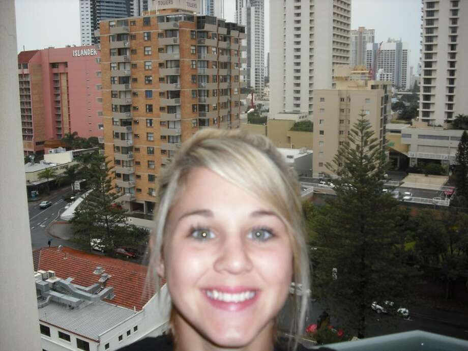 Adriana Welborn poses in front of the downtown skyline of the city of Gold Coast, Queensland, Australia.
