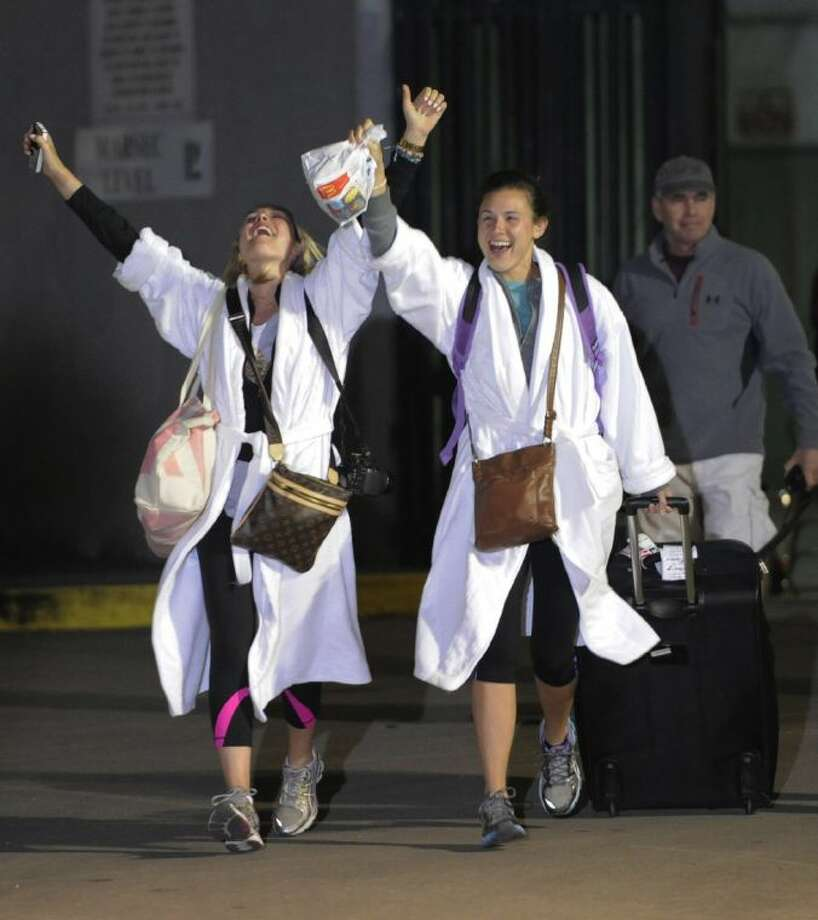 Kendall Jenkins, left, of Houston, celebrates with Brittany Ferguson, of Houston, after getting off the Carnival Triumph in Mobile, Ala., Thursday. Photo: John David Mercer