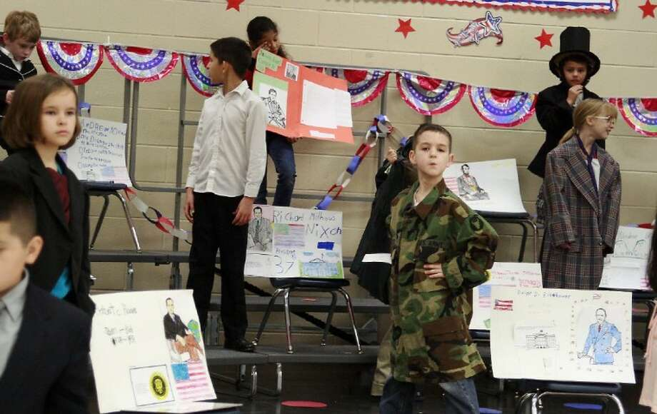 Bens Branch Elementary second-graders stand as wax sculptures of their favorite presidents at the school's Presidential Wax Museum Feb. 21.