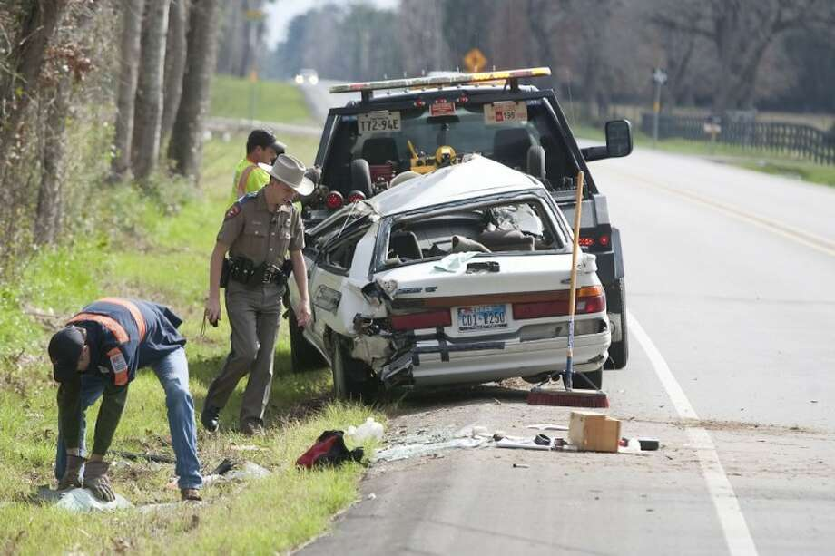 A Texas Department of Public Safety Trooper investigates the scene of a single-vehicle accident on FM 149 north of FM 1488 Tuesday afternoon near Magnolia. The driver was transported by ambulance to Conroe Regional Medical Center. Photo: Karl Anderson