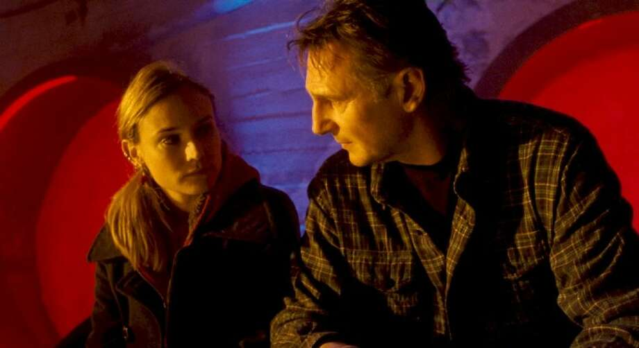 "In this film publicity image released by Warner Bros. Pictures, Diane Kruger, left, and Liam Neeson are shown in a scene from, ""Unknown."""