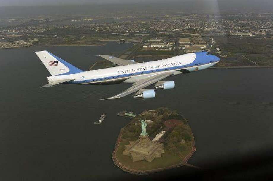 In this photograph released by the White House, Air Force One flies over the Statue of Liberty in New York in this undated photograph. / The White House