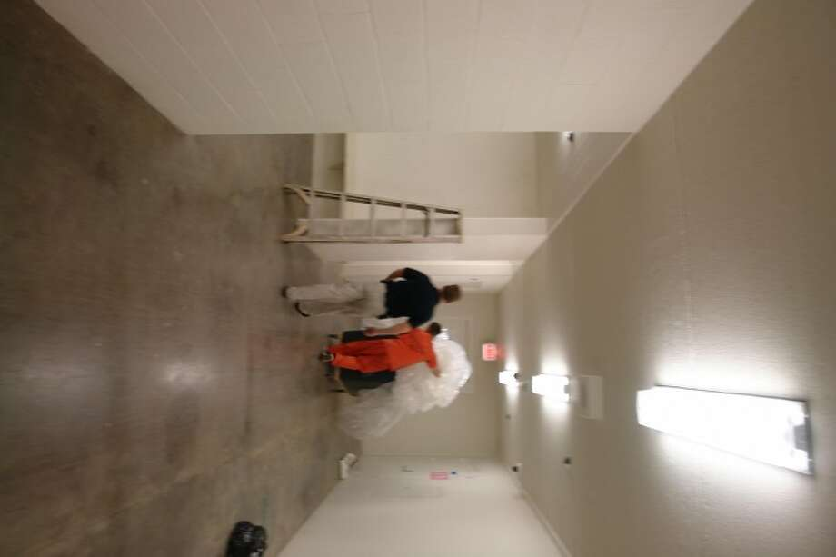 A Montgomery County jail inmate cleans up a hallway in the Joe Corley Detention Center, which opens this week.