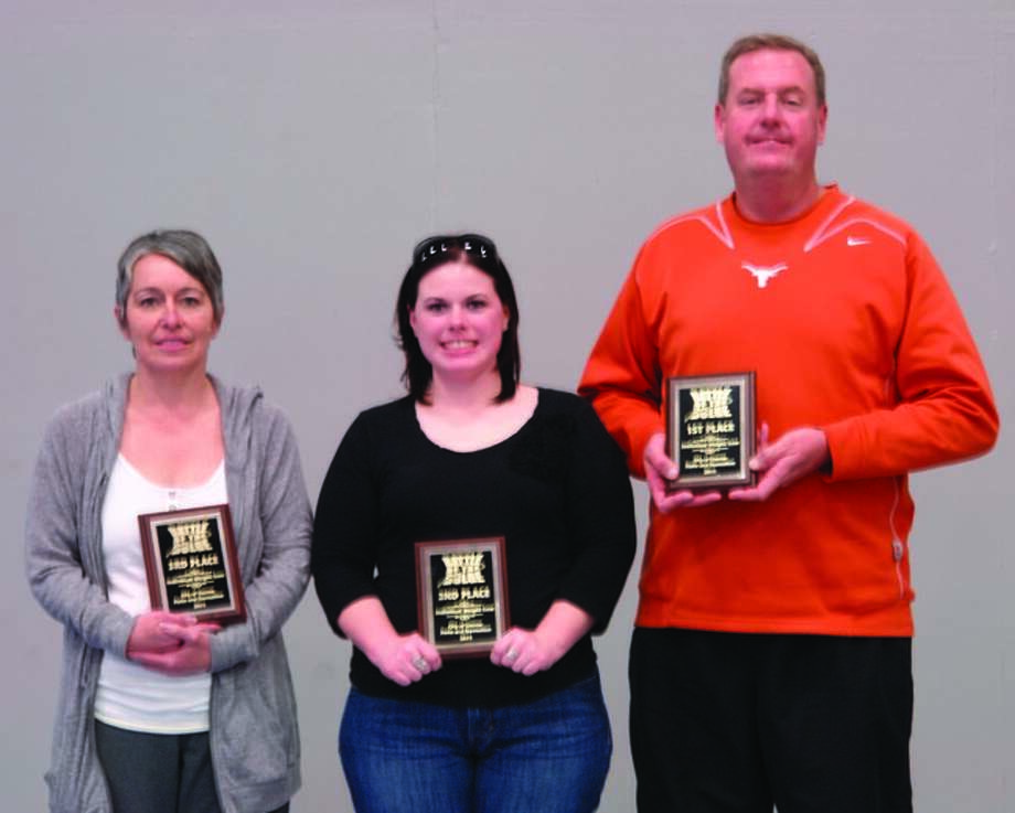 Pictured from left, Rae Smith, who came in third place for losing 11.8 percent of her body weight and 19 pounds; Michelle Hauck, who came in second place for losing 25 pounds and losing 12.4 percent of her body weight; and Jim Hamilton, who came in first place, for losing 13.1 percent of his body weight and 37 pounds during the second annual Battle of the Bulge at the Conroe Recreation Center throughout a six-week period.