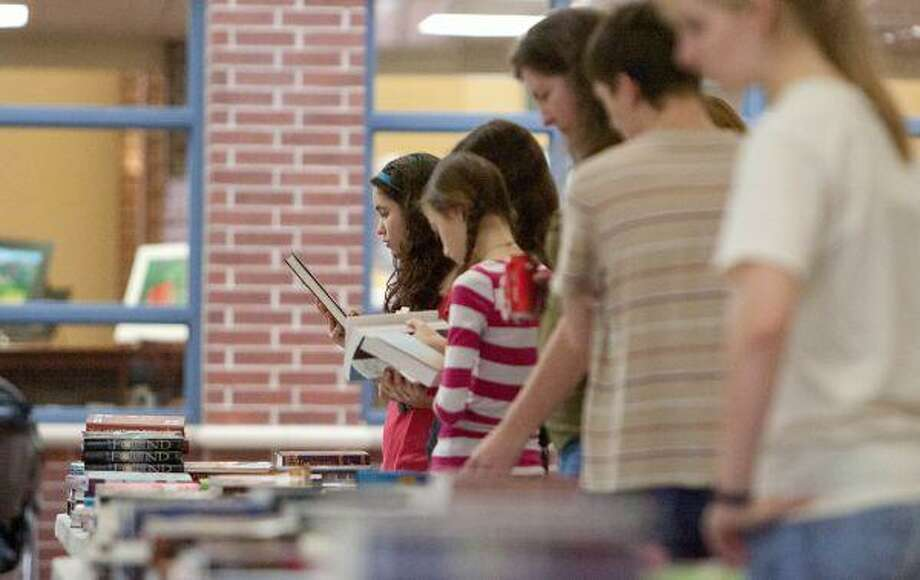 Teens take an opportunity to check out the latest books during the 6th Annual Montgomery County Teen Book Festival Saturday at College Park High School in The Woodlands. / The Courier