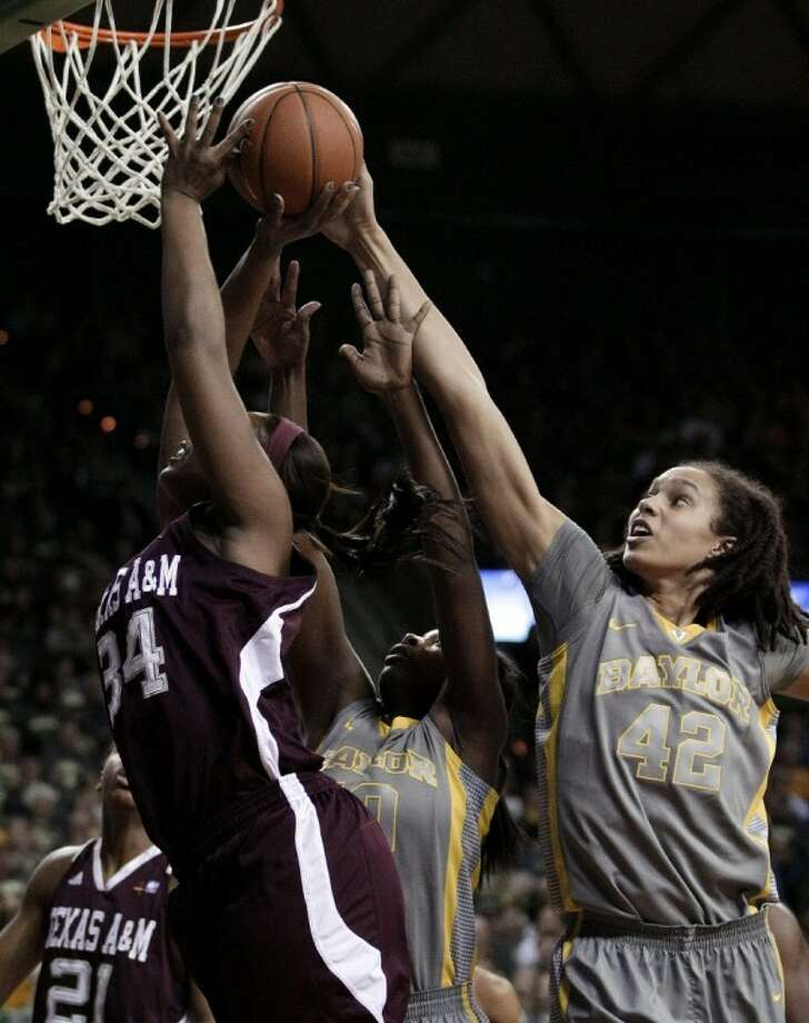 Baylor's Brittney Griner (42) blocks a shot attempt by Texas A&M 's Karla Gilbert (34) in the first half of an NCAA college basketball game Saturday, Feb. 11, 2012, in Waco. Photo: Tony Gutierrez