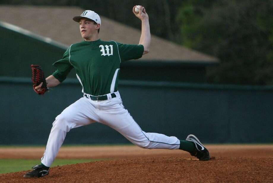 The Woodlands' Ryan Burnett fires a pitch against Flower Mound during Saturday's tournament game at Scotland Yard.