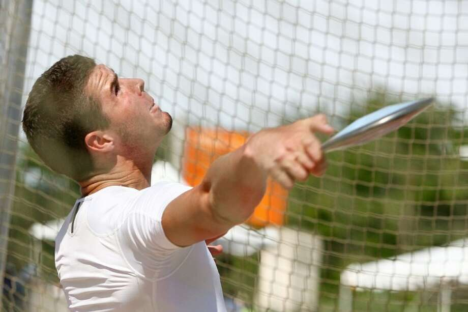 Oak Ridge High School senior Dalton Rowan, above at last year's state meet, set a pair of school records on Saturday in the discuss and shot put. Rowan, the defending Class 5A state discuss champion, signed with Texas A&M last week.