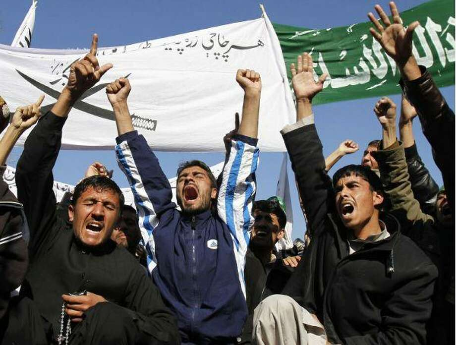 Afghans chant anti-American slogans during a protest in Jalalabad, east of Kabul, Afghanistan Thursday. Thousands gathered to protest after four Afghan children and a policeman were killed and scores wounded, including at least three American troops when an explosion tore through a group of local residents and soldiers observing a road-construction project on Wednesday in Nangarhar province. / AP2009
