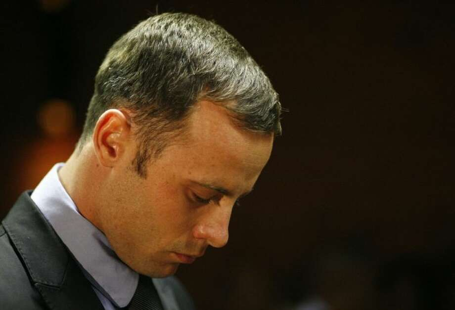 Olympic athlete Oscar Pistorius stands during his bail hearing at the magistrate court in Pretoria, South Africa, Thursday. Photo: Themba Hadebe