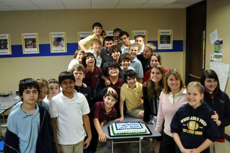"""Mia Harpel thanks her sixth-grade class at The Woodlands Preparatory School for the special surprise party they threw in her honor. The students worked behind the scenes to decorate the lunch room with balloons and order pizza for lunch. They also had a special cake made which read, """"Happy Birthday Teacher Harpel!"""""""
