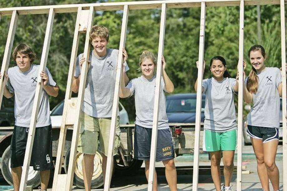 The John Cooper School Habitat for Humanity student chairs, from left to right, Wes Dunner, Bryce Poeter, Allex Murphy, Preeya Goradia and Maripau Nunez lift a wall-frame. The John Cooper School has partnered up with Habitat for Humanity to construct a home for a deserving family. / Staff