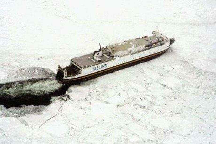 In this handout photo released by the Swedish Coast Guard, a cargo ship is seen trapped in ice in the Baltic Sea on Thursday. Sweden's sea rescue service says four passenger ferries with more than 1,000 people on board are trapped in ice in the Baltic Sea. The Swedish Maritime Administration says that there are 1,133 passengers and crew on the four ships, which have been stuck for hours just off the Swedish coast. / AP2010