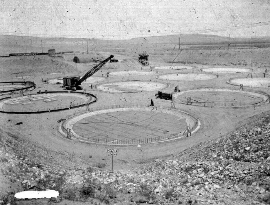 "This photo provided by the U.S. Dept. of Energy shows the construction of a ""tank farm"" to store nuclear waste in 1944 on the Hanford nuclear reservation near Richland, Wash. It is one of collection of photos documenting life in and around the reservation from 1943-1967. Photo: HOPD"
