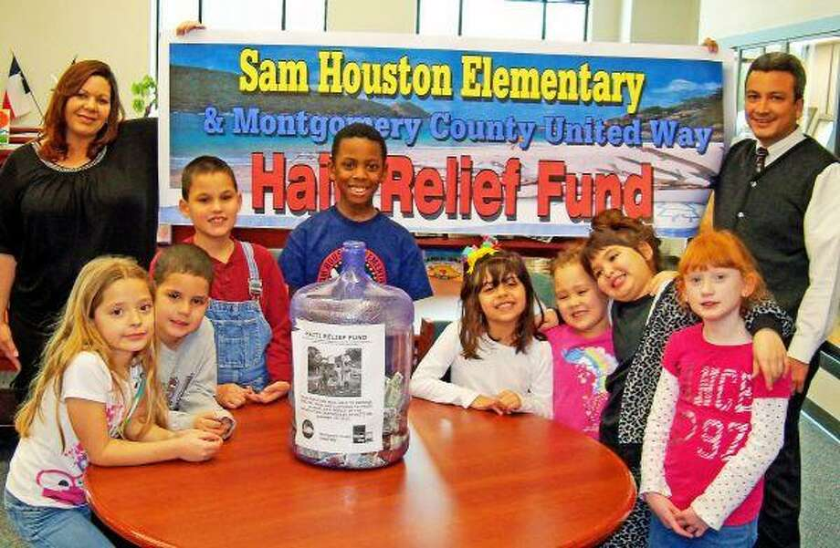 Sam Houston Elementary counselor Natali Gee, back row, left, and Principal Ivan Velasco, right, pose with students representing Sam Houston Elementary's efforts to support relief in Haiti. The school, where 91 percent of the student population is economically disadvantaged, raised $425 toward the United Way Worldwide Disaster Fund for Haiti.
