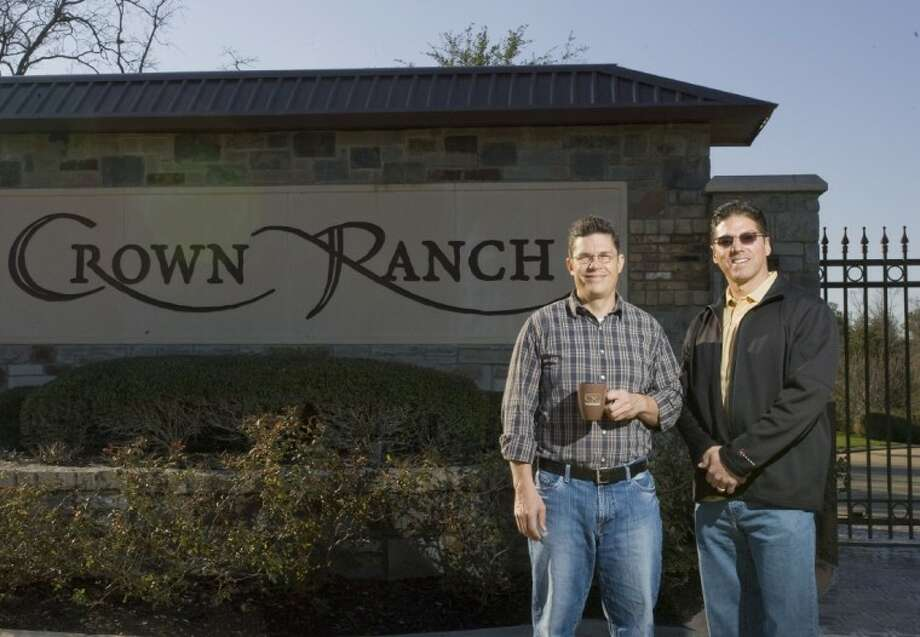 Crown Ranch developers Eric Estes, left, and Michael Weingrad stand for a photograph outside the entrance to the community in Magnolia. Photo: Staff Photo By Eric S. Swist