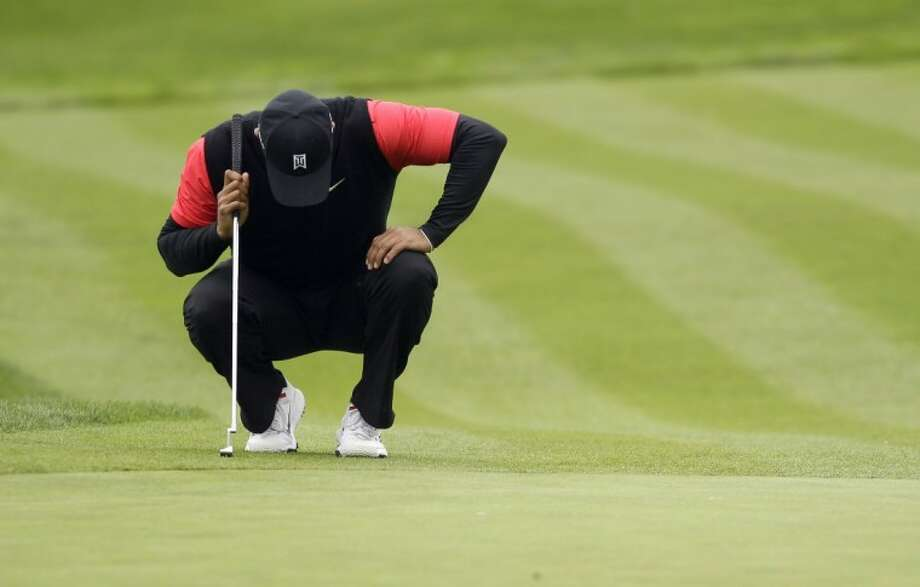 Tiger Woods hunkers down at the fifth green at Pebble Beach Golf Links during the final round of the AT&T Pebble Beach National Pro-Am golf tournament in Pebble Beach, Calif., Sunday. Photo: Eric Risberg