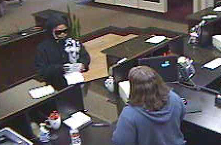 MCSO Detective David Eason said the Tradition Bank, located at 3205 College Park Drive, was robbed at about 2:30 p.m. Monday when a black man wearing dark pants, a black hoodie and sunglasses entered the bank, showed a note to a teller requesting money and left the back with an undisclosed amount of cash.