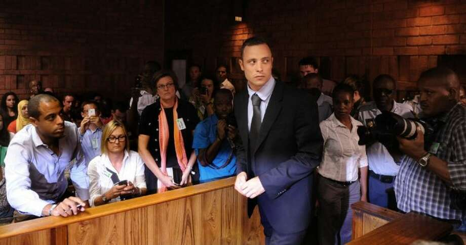 Olympic athlete Oscar Pistorius stands in court Friday in Pretoria, South Africa, for his bail hearing. Photo: Uncredited