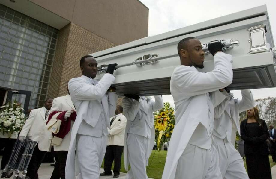 Pallbearers carry the casket of Eddie Ruth Lagway following funeral services at Lynn Lucas Middle School in Willis Saturday. Photo: Staff Photo By Eric S. Swist