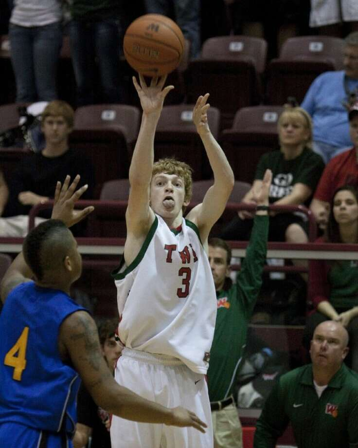 The Woodlands' Nolan Cass is in the finals to be in a 3-point contest to air on CBS. To vote for him, go to www.highschoolslam.com. Photo: Photographer: Gabriel Chmielewsk