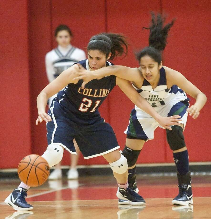 College Park's Uma Rajagopalan and Klein Collins' Dom Dillingham fight for the ball Tuesday at Tomball High School. See more photos online at www.yourconroenews.com/photos. Photo: Karl Anderson