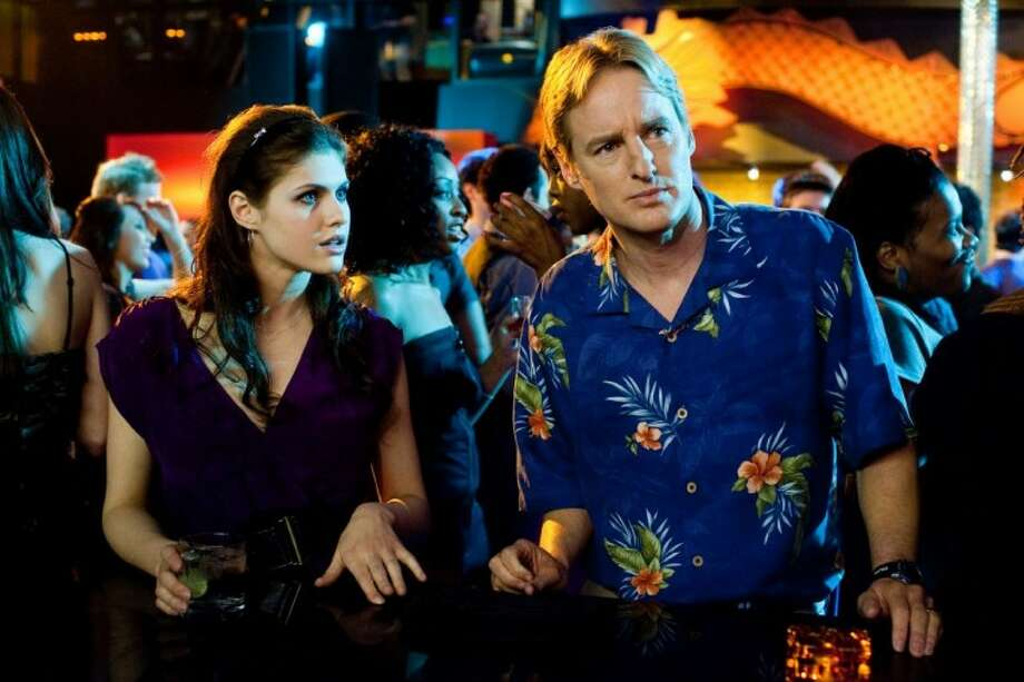 "In this film publicity image released by Warner Bros., Alexandra Daddario, left, and Owen Wilson are shown in a scene from, ""Hall Pass."""