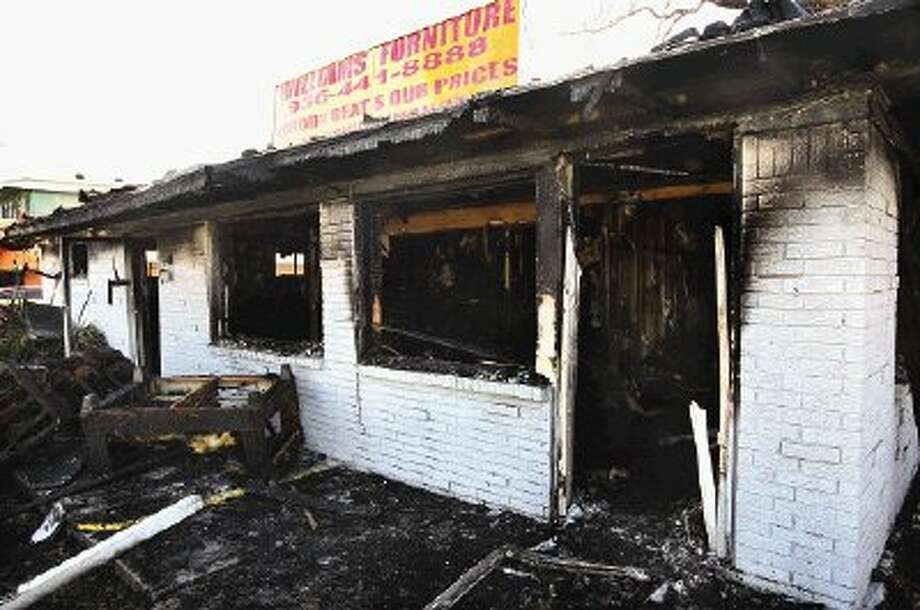 A two-alarm fire destroyed the building housing Williams Furniture in downtown Conroe and all its contents Monday night.