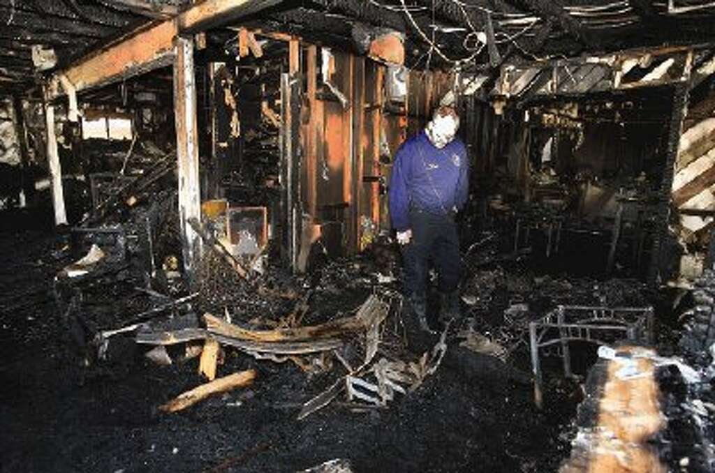 Conroe Deputy Fire Marshal Andy Nokes Searches For Clues To The Cause Of  The Fire That