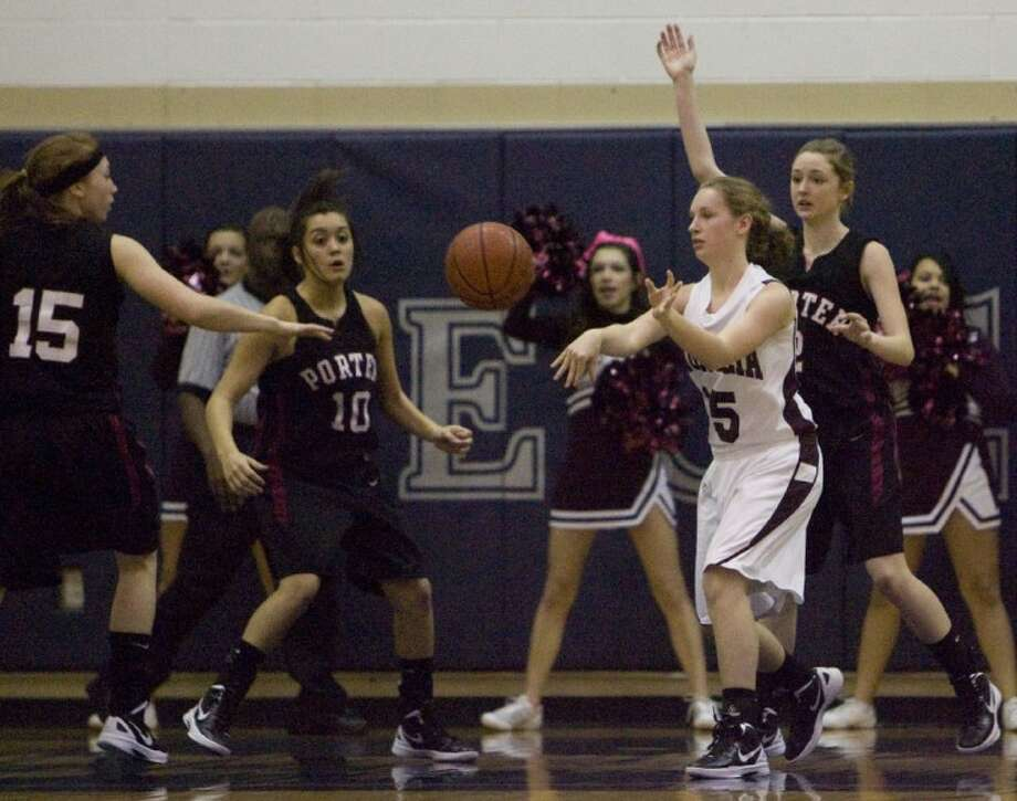 Magnolia's Morgan Frazier makes a pass as she comes under pressure from Porter defenders during Tuesday's Region III-4A bi-district playoff game at College Park High School. Photo: Staff Photo By Eric S. Swist