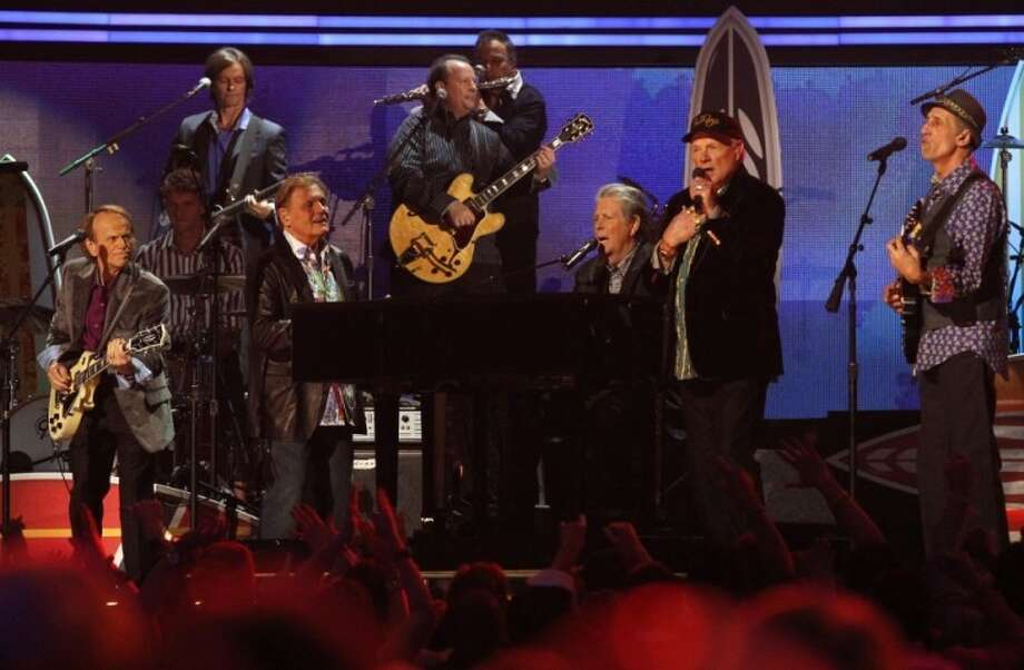 Original Beach Boys members Brian Wilson, Mike Love and Al Jardine perform together for the first time in more than two decades on the Grammy stage Sunday night. The reunited band will perform June 8 at the Cynthia Woods Mitchell Pavilion in The Woodlands as part of a 50th anniversary tour.