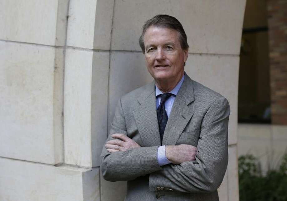 In this Thursday, Nov. 29, 2012 file photo, University of Texas president Bill Powers poses for a photo at the University of Texas, in Austin, Texas. Texas Lt. Gov. David Dewhurst says the Legislature should hold hearings to look into efforts to oust Powers. Photo: Eric Gay