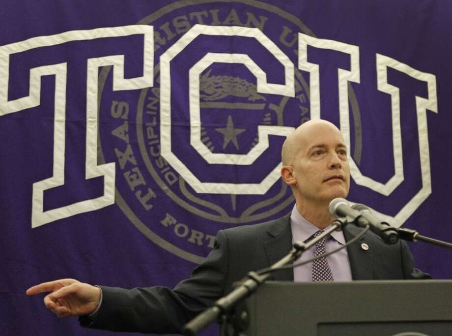 Texas Christian University Chancellor Victor Boschini gestures during a news conference in Fort Worth Wednesday. Police say four TCU football players are among 17 students who have been arrested in a campus drug bust. TCU Police Chief Steve McGee said the students arrested Wednesday were caught in an undercover operation selling marijuana, cocaine, ecstasy and prescription drugs. Photo: Paul Moseley