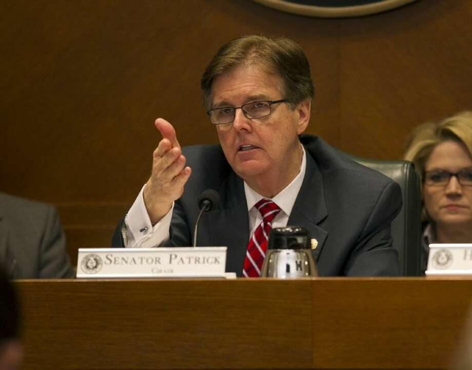 Sen. Dan Patrick motions to people giving testimony at the Senate Committee on Education at the Capitol on Tuesday. Members of the committee demanded answers on the exam regime known as the State of Texas Assessment of Academic Readiness, or STAAR, particularly asking why so many high school students are failing it. Photo: Deborah Cannon