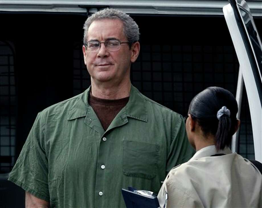 In this Aug. 24, 2010 file photo, R. Allen Stanford arrives in custody at the federal courthouse for a hearing in Houston. On Tuesday, Jan. 24, 2012, after much delay, federal prosecutors in Houston are due to begin laying out their case against Stanford, telling jurors that the 61-year-old's business empire was built on smoke and mirrors and that he bilked investors out of more than $7 billion over 20 years as part of a massive Ponzi scheme. (AP Photo/David J. Phillip, File) Photo: AP Photo By David J. Phillip / AP2010