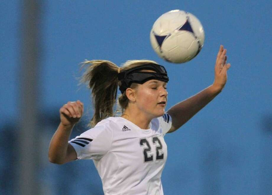 College Park midfielder Sammy Mount heads the ball during a high school girls soccer game at College Park High School on Tuesday. To view or order this photo, or others like it, visit: HCNPics.com. Photo: Jason Fochtman