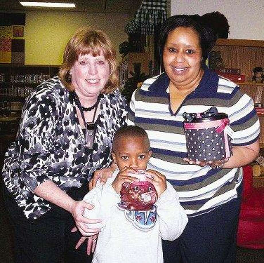 Students at Montgomery Elementary School recently participated in fundraising for the Red Cross to benefit Haiti. The program, called Dimes for Disaster, prompted J'vion Poplar in Jean BonJorno's kindergarten class to donate the entire contents of his piggy bank. Pictured are Jean BonJorno, J'vion Poplar and Andrea Coleman.