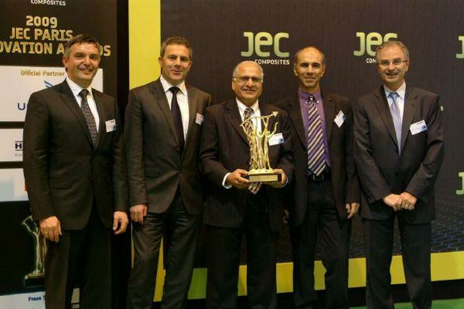 Ash Chaudhari, technical director at Huntsman Advanced Technology Center, receives the JEC Composites innovative materials award in Paris.