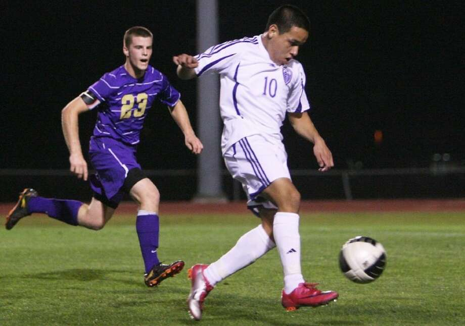 Willis' Alex Alfaro dribbles downfield as Montgomery's Chase Hall closes in during Friday night's game in Willis.