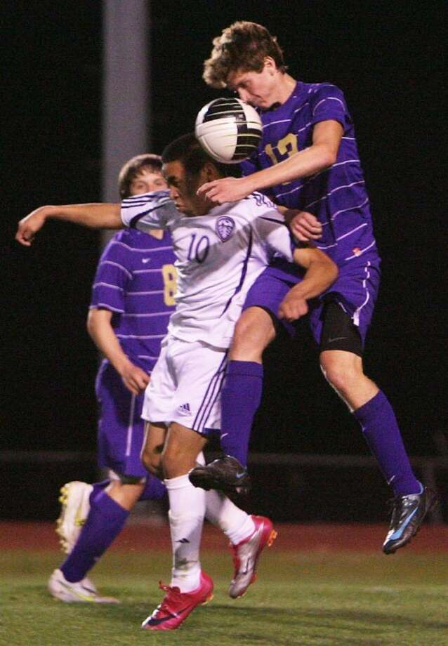 Montgomery's Will Nemeth collides with Willis' Alex Alfaro during a match earlier this season. Nemeth was named the District 39-4A Co-Defensive Player of the Year, while Alfaro was named first team all-district. Photo: Eric S. Swist