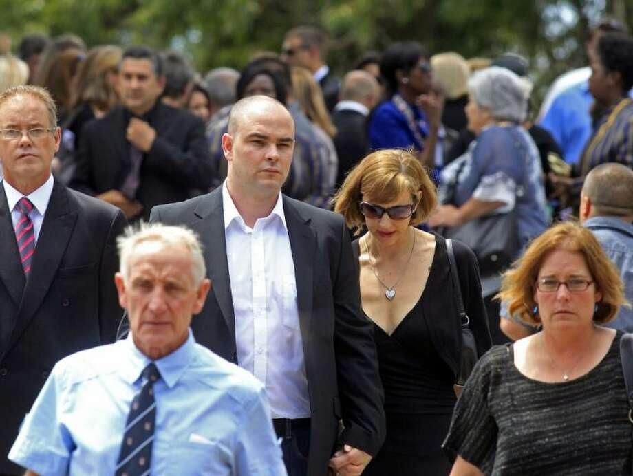Adam Steenkamp, center left, the brother of Reeva Steenkamp, walks with family members after attending her funeral, in Port Elizabeth, South Africa, Tuesday. Photo: Schalk Van Zuydam